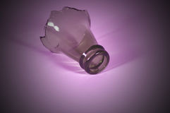 Bottle top - purple. The top of a broken bottle, purple color cast and vignetting Royalty Free Stock Image