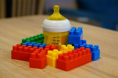 Bottle and toy blocks Royalty Free Stock Photos