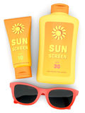 Bottle and tube of sunscreen and red sunglasses Royalty Free Stock Photos