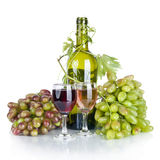 Bottle, two glass of wine and ripe grapes  on white back Stock Photos