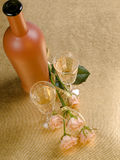 Bottle,two glass with wine and roses Stock Images