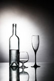 Bottle with two glasses Stock Photos