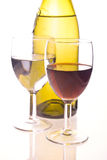 Bottle and two glasses. Two glasses and a wine bottle against white background Royalty Free Stock Image