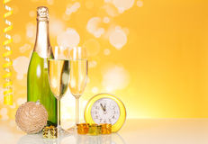 Bottle, two glasses of champagne near the clock Stock Photography