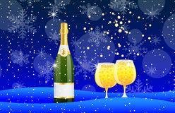 Bottle and two glasses of champagne on to snow Stock Image