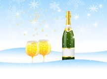 Bottle and two glasses of champagne on to snow Royalty Free Stock Image