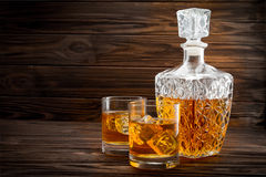 Bottle and two glasses with ice and whiskey Stock Photo