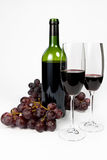Bottle and two glasses of red wine. On white background Stock Photos