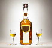 Bottle And Two Glasses of Spirit Drink Royalty Free Stock Photo