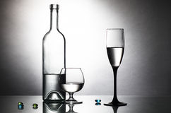 Bottle and two glasses on table Stock Image
