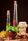 Bottle with vegetable oil and fresh spices royalty free stock images
