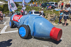The Bottle Vehicle. Port de Pilheres,France-6 July, 2013: A bottle shaped vehicle advertising Vittel driving on the road to Col de Pailheres during the passing Royalty Free Stock Images