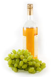 Bottle of vine and grape royalty free stock images