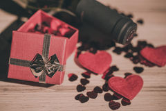 Bottle of vine, red hearts and small present a retro style Royalty Free Stock Photo