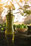Bottle virgin olive oil on black background Royalty Free Stock Photos