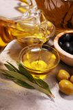Bottle virgin olive oil and oil in a bowl with some olives.  Royalty Free Stock Photo