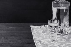 Bottle of vodka with glasses on the wooden table Stock Photography