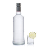 bottle of vodka with lime isolated on white Stock Photography
