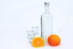 Bottle of vodka with orange Royalty Free Stock Photo