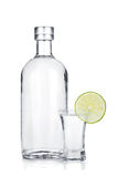 Bottle of vodka and shot glass with lime slice Royalty Free Stock Image