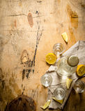 Bottle of vodka with shot glasses and lemon. On wooden background Stock Photos
