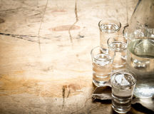 Bottle of vodka with shot glasses. Royalty Free Stock Photos