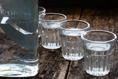 Bottle of vodka and shot glasses Royalty Free Stock Photos