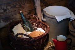 A bottle of vodka in a wicker basket. Drinks in a glass bottle i stock image