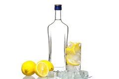 Bottle of vodka and wine glass with lemon and ice isolated on wh Stock Photos
