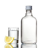 Bottle of vodka and wineglass with lemon Royalty Free Stock Photo