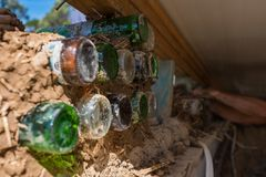 Bottle wall and cob, ecological, recycling building technology Stock Photo
