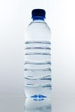 Bottle of water. Photo of an isolated plastic bottle of still water with reflection stock photography