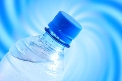 Bottle of water. On blue background Royalty Free Stock Images