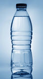 Bottle of water. On blue background Royalty Free Stock Photography