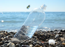 Bottle of the water on the beach royalty free stock image