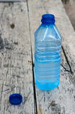 Bottle of water in blue Royalty Free Stock Images