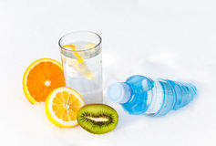Bottle of water with citrus fruit Stock Image