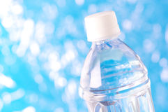 Bottle of water on defocused sparkle background. Stock Photo