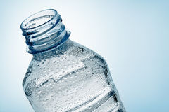 Bottle of water with droplet. Top view of a fresh plastic bottle of water with droplet royalty free stock photos