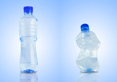 Bottle with water, empty and crushed Royalty Free Stock Image