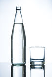 Bottle of water and empty glass Stock Photo