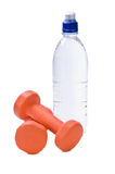 Bottle of water with fitness weights Royalty Free Stock Photos