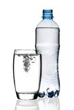 Bottle of water and glass. Bottle of water and glass with bubbles, isolated on white background stock photography