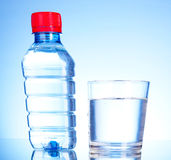Bottle of water and glass Royalty Free Stock Photo