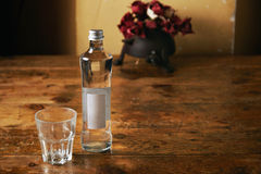 Bottle of water and glass in rustic kitchen Royalty Free Stock Photo