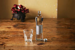 Bottle of water and glass in rustic kitchen Royalty Free Stock Photography