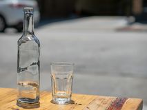 Bottle of water and glass served at an outdoor restaurant royalty free stock photo