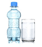 Bottle of water and glass Stock Photos