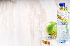 Bottle of water and green apple Stock Photography