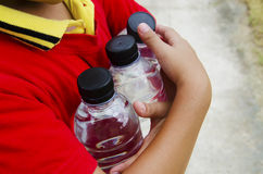 Bottle of water in hand Stock Image